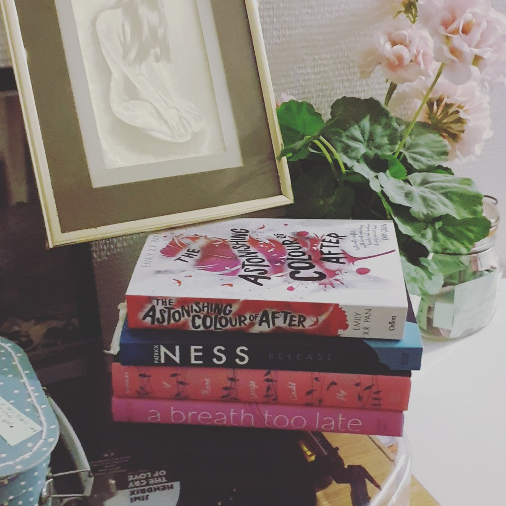 TBR-Pile-bookstagram-for-authors-susan-shiney-bookstagram-for-writers-fake-flowers-golden-picture-frame