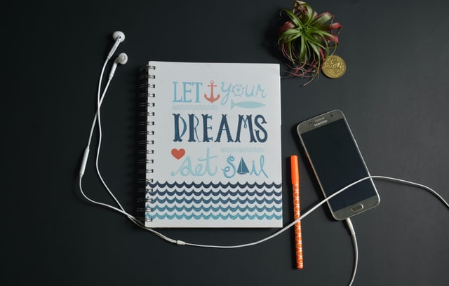 Go-for-your-dreams-notebook-planning-for-success-reasons-to-apply-to-Author-mentor-match-process-susan-shiney-kelli-stirrett-unsplash