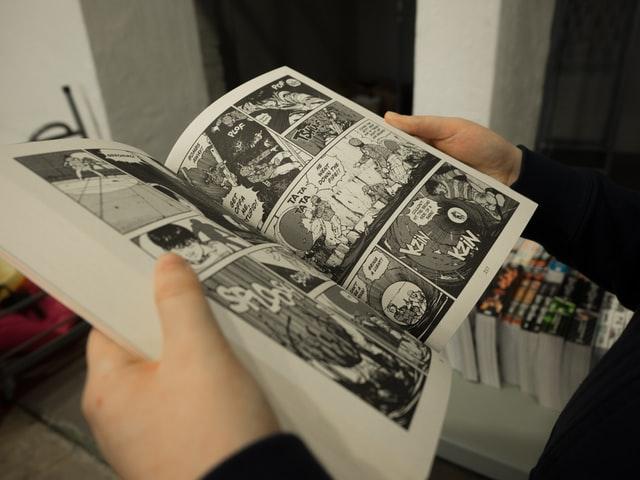 Open-comic-book-how-graphic-novels-help-my-writing-susan-shiney-why-read-graphic-novels-miika-laaksonen-unsplash